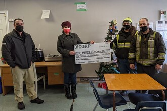 (L to R) Di-Corp's Chad Smith and Katarina Kosy present a cheque to H.O.P.E.'s Kitchen founders Katie Valiquette and Chris Brown.
